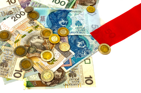 zloty: Polish zloty. Many banknotes, coins of different denomination and the Polish flag.