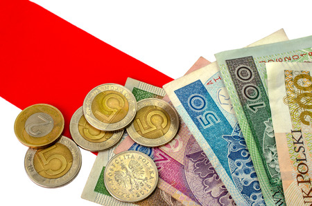zloty: Polish zloty. Many banknotes and coins of different denomination and the Polish flag.