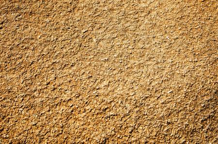 rough: Light-brown rough surface. Close-up.