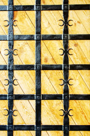 grate: Wooden doors with wrought-iron grate. Close-up. Stock Photo