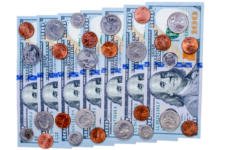 Banknotes of one hundred dollars and many coins. Flat view. Isolated. Stock Photo