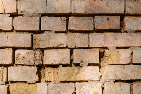 Details of textured aged brick wall. Can be used as background. Close-up. Stock Photo
