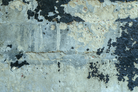 Texture of old rough cement or concrete wall with cracked resin. Can be used as background. Close-up.