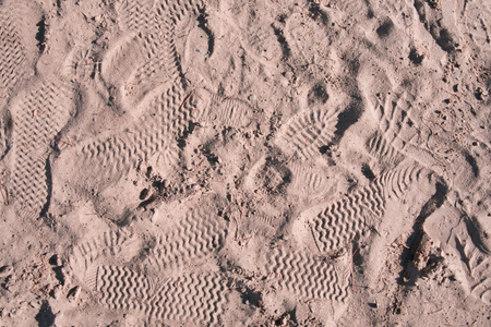 Footprints in the sand. Abstract texture. Close-up.