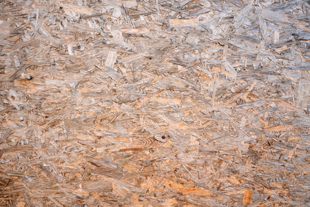 OSB boards compressed sawdust or chipboard. Abstract texture background compressed sawdust or pressed wooden panel. Close-up. Stock Photo