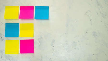 Set of several blank colorful post notes with copy space for text on light background. Concept prepare for teamwork or brainstorming. Top view. Flat lay. Close-up. Indoors.