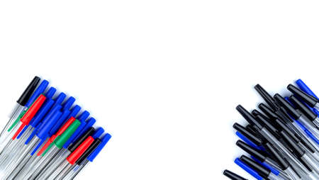 Pile of a lot multi colored plastic ballpoint pens isolated on white background. Abstract stationery background. 16x9 format. Top view. Close-up. Many objects. Archivio Fotografico