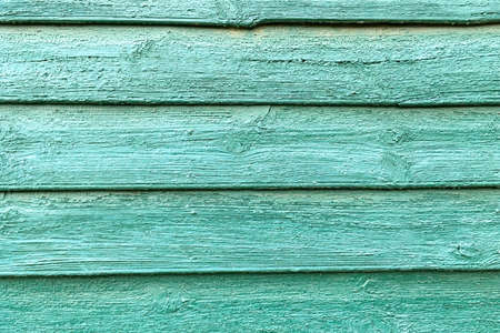 Old natural turquoise wooden wall of boards as great background or texture. Close-up. Outdoors. Archivio Fotografico