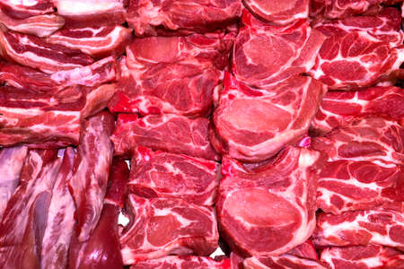 Different juicy and quality raw meat on counter for sale in butchers shop. Chopped meat in store. Food background. Selective soft focus. Close-up. Indoors.