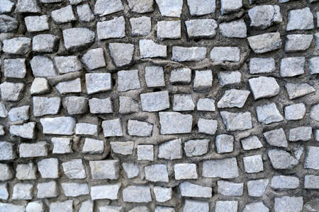 Gray abstract tile mosaic wall or floor as decorative background. Soft focus. Close-up. Outdoors. Archivio Fotografico