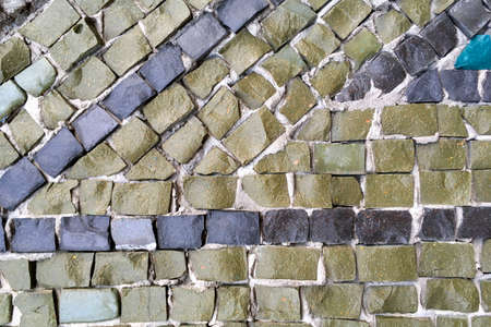 Abstract tile mosaic wall or floor as decorative background. Soft focus. Close-up. Outdoors.