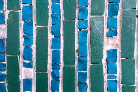 Blue-green abstract tile mosaic wall or floor as decorative background. Soft focus. Close-up. Outdoors. Archivio Fotografico