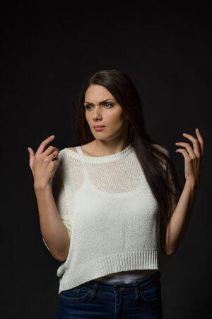 White caucasian girl posing emotionally isolated on background