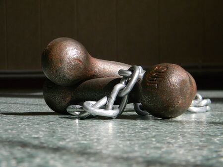 Dumbbells with chains lying on the floor