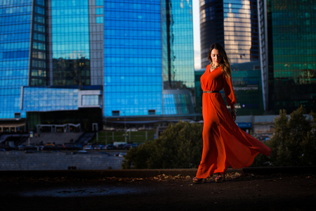 maxi dress: beautiful girl in maxi dress in Moscow in summer sunset