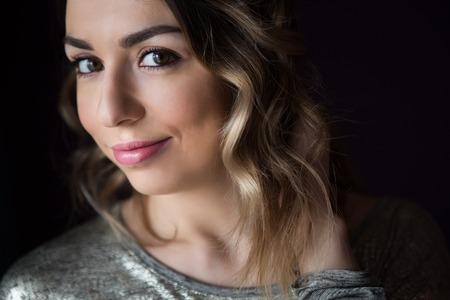 horizontal haircut: Beautiful young woman look makeup eyelashes smile Stock Photo