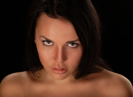 Portrait sexy woman in a black background Stock Photo - 15832194