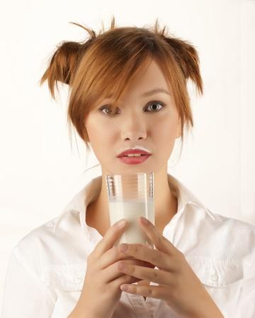 woman holding glass of milk Stock Photo - 15871623