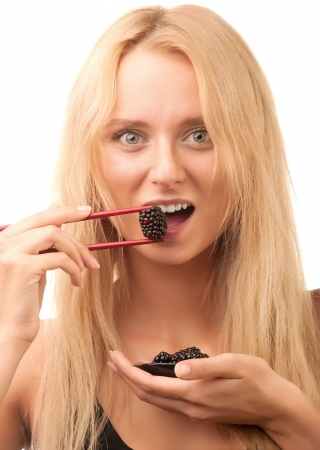 girl eating blackberries berries photo
