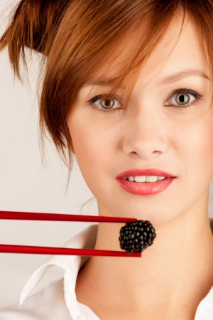 girl eating blackberries berries Stock Photo - 15871631
