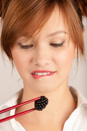 girl eating blackberries berries Stock Photo