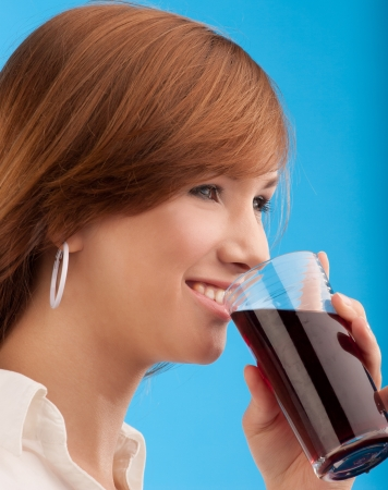 woman holding glass of juice Stock Photo - 15871636