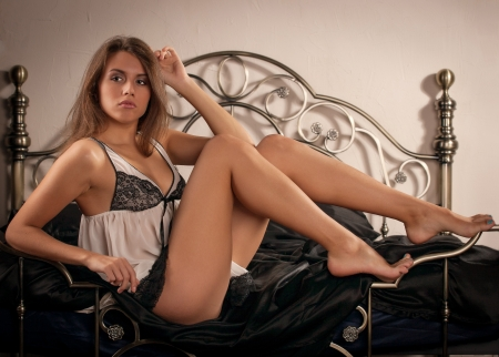 woman lying on the bed Stock Photo - 17395065