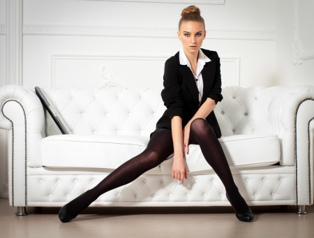 businesswoman wiht laptop sitting on the sofa Stock Photo