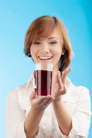 woman holding glass of juice