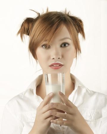 woman holding glass of milk Stock Photo - 17395067