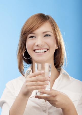 woman holding glass of water Stock Photo