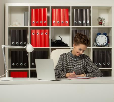 teacher sitting at a desk Stock Photo - 17395090