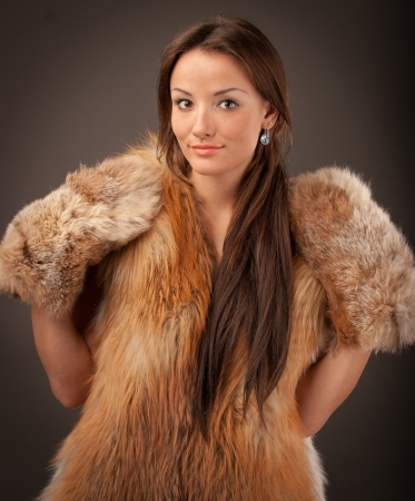 portrait of a young woman with a fur vest mittens Stock Photo - 17395086