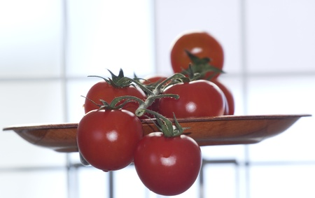 cherry tomatoes on a branch Stock Photo - 17587591