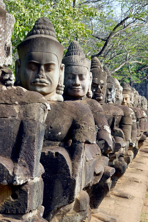 angkor thom: Cambodia. Siem Reap. South gate of Angkor Thom. Statues of mythical.