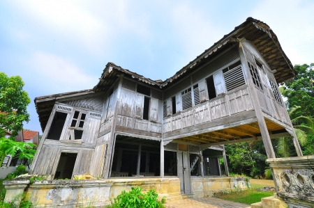 malay village: Abandoned traditional malay wooden house Stock Photo