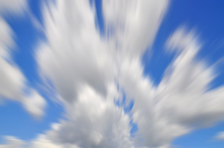 Long Exposure Of Blue Sky With Motion Clouds For Background photo