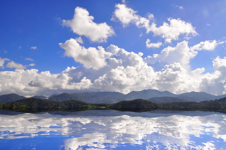 stratus: Reflection Of Clouds, Mountains And Blue Sky Over The Lake For Background  Stock Photo