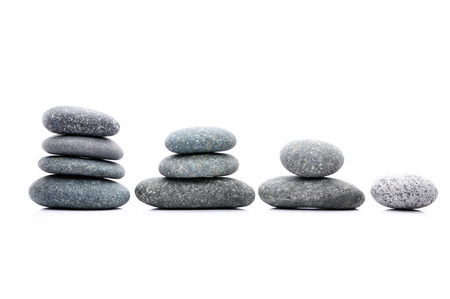 Zen And Spa Stone Stacking Over White Background