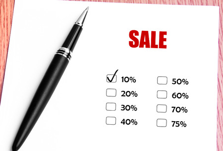 discounted: Close Up Black Pen With Checked 10 Discounted Rate At Sale Promotion Stock Photo