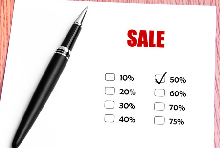 discounted: Close Up Black Pen With Checked 50 Discounted Rate At Sale Promotion