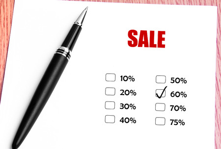 discounted: Close Up Black Pen With Checked 60 Discounted Rate At Sale Promotion Stock Photo