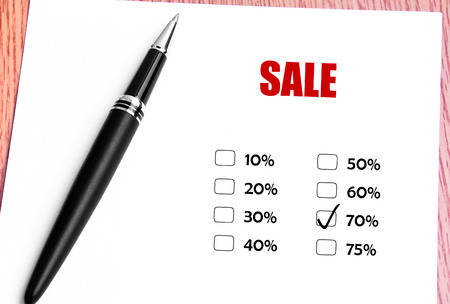discounted: Close Up Black Pen With Checked 70 Discounted Rate At Sale Promotion
