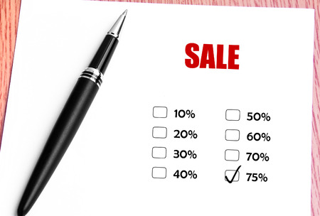 discounted: Close Up Black Pen With Checked 75 Discounted Rate At Sale Promotion