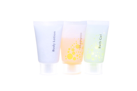 amenities: Hotel Amenities  Body lotion shampoo and bath gel Isolated On White