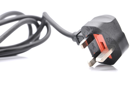 Black Power Cable With Plug And Socket Over White Background ~ Selective Focus photo