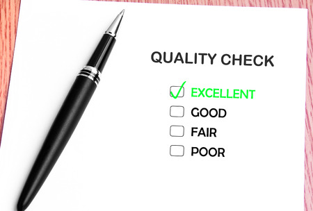 Close Up Pen And List Of Quality Check Checked On Excellent  photo