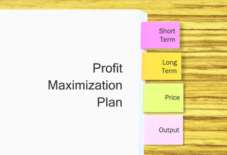 maximization: Stack Of A4 Paper With Colorful Tagging For Easy Reference For Profit Maximization Plan In Business Concept