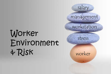 Stack Of Rocks Over Fragile Chicken Egg For Worker Environment And Risk Concept  photo