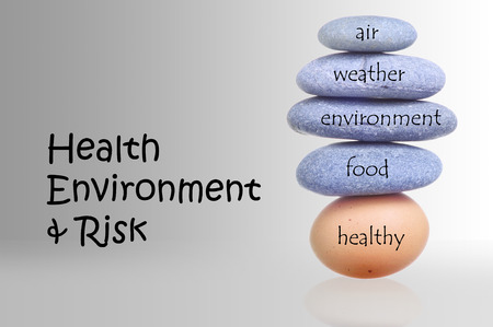 Stack Of Rocks Over Fragile Chicken Egg For Health Environment And Risk Concept  photo